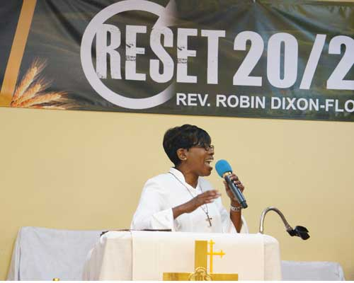 rev robin dixon-floyd speaking at a conference